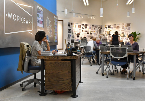 Workbar members sit in the cafe area of the Workbar at Staples location on Tuesday, Sept. 13, 2016 in Brighton, Mass.  Staples and Workbar are creating more productive workspaces with coworking locations within three Massachusetts Staples stores. (Josh Reynolds /AP Images for Staples)