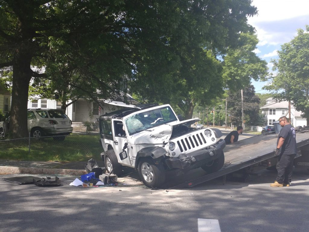 UPDATED: Jeep Rolls Over in Crash at Grant and Mansfield