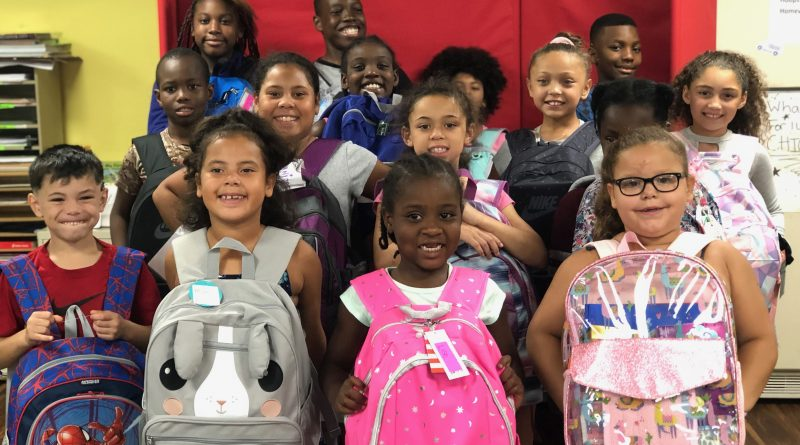 PHOTO OF THE DAY: New Backpacks For Hoops & Homework Students